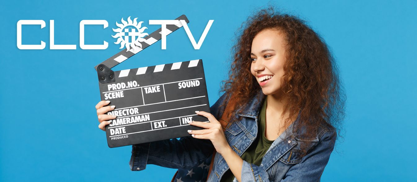 young woman holding video slate